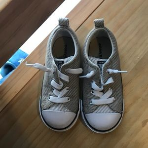 Tan and white converse